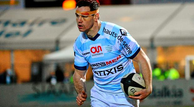 A heavily bandaged Johnny Sexton in action for Racing Metro on Saturday. Photo: Dave Winter / SPORTSFILE