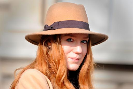 Sarah Nunn wears a hat by Primark at Somerset House, London as she attends a London Fashion Week event