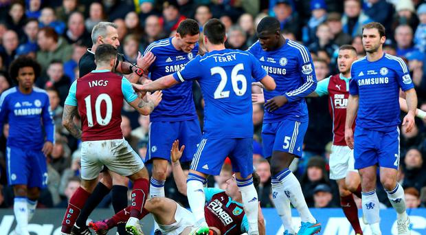 Chelsea's Nemanja Matic pushes Burnley forward Ashley Barnes to the ground and is subsequently sent off. Photo: Paul Gilham/Getty Images