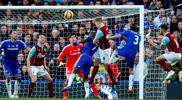 Ben Mee heads in Burnley's equalising goal in their Premier League clash with Chelsea at Stamford Bridge. Photo: Julian Finney/Getty Images