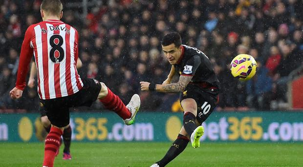Philippe Coutinho fires Liverpool into an early lead in their Premier League clash with Southampton at St Mary's. Photo: Reuters / Dylan Martinez / Livepic