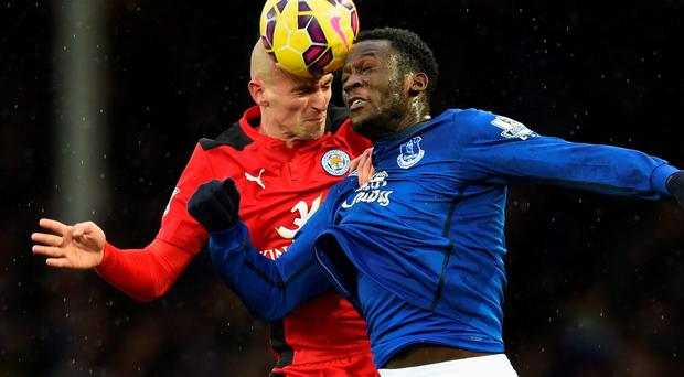 Everton striker Romelu Lukaku competes for a header with Leicester City's Esteban Cambiasso during their Premier League clash at Goodison Park. Photo: Michael Regan/Getty Images