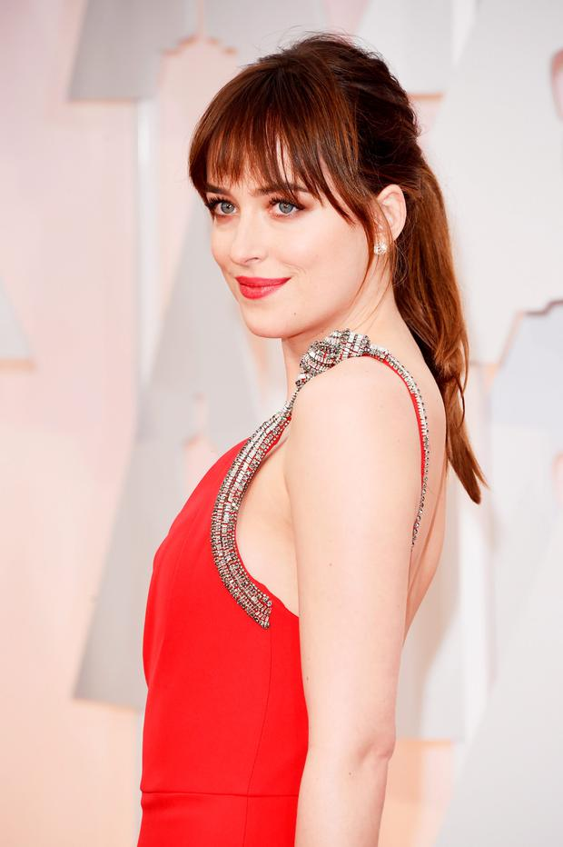 HOLLYWOOD, CA - FEBRUARY 22: Actress Dakota Johnson attends the 87th Annual Academy Awards at Hollywood & Highland Center on February 22, 2015 in Hollywood, California. (Photo by Jason Merritt/Getty Images)