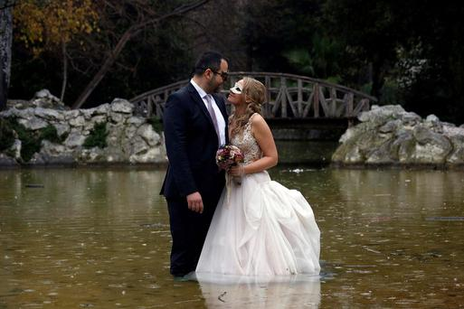 Despoina Symeonidou, 29, and Vasilis Markou, 39, are photographed after their wedding at the national garden in Athens. Greek Prime Minister Alexis Tsipras declared victory on Saturday after agreeing a last-minute conditional financial rescue deal with Europe, despite making big concessions to avert financial collapse within days (REUTERS/Kostas Tsironis)