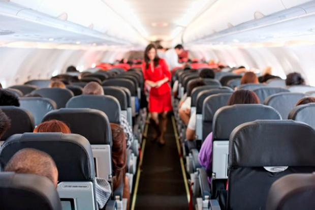 A coroner has warned that toxic fumes in plane cabins pose a risk of health damage to aircrew and frequent fliers (Getty)