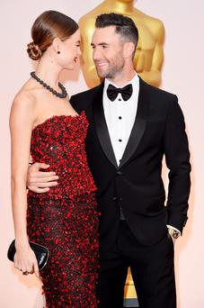 Adam Levine and Behati Prinsloo attend the 87th Annual Academy Awards at Hollywood & Highland Center last year. (Photo by Jason Merritt/Getty Images)