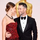 HOLLYWOOD, CA - FEBRUARY 22: Recording artist Adam Levine (R) and Behati Prinsloo attend the 87th Annual Academy Awards at Hollywood & Highland Center on February 22, 2015 in Hollywood, California. (Photo by Jason Merritt/Getty Images)