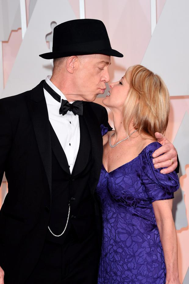 HOLLYWOOD, CA - FEBRUARY 22: Actor J.K. Simmons (L) and Michelle Schumacher attend the 87th Annual Academy Awards at Hollywood & Highland Center on February 22, 2015 in Hollywood, California. (Photo by Jason Merritt/Getty Images)