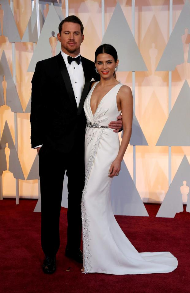 Actor Channing Tatum and wife Jenna Dewan arrive at the 87th Academy Awards in Hollywood, California February 22, 2015. REUTERS/Mario Anzuoni (UNITED STATES - Tags: ENTERTAINMENT) (OSCARS-ARRIVALS)