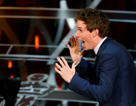 Actor Eddie Redmayne reacts after winning the Oscar for best actor for his role in