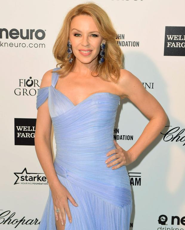 Australian singer Kylie Minogue arrives at the 2015 Elton John AIDS Foundation Oscar Party in West Hollywood