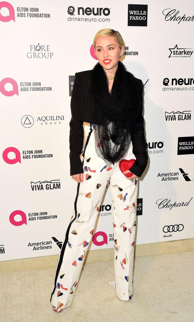 Singer Miley Cyrus arrives at the 2015 Elton John AIDS Foundation Oscar Party in West Hollywood