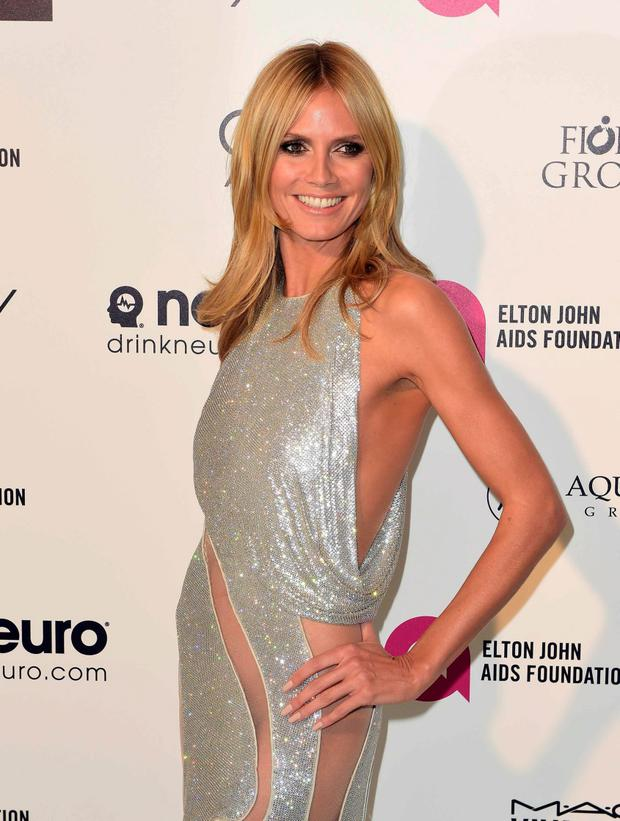 Model and TV personality Heidi Klum arrives at the 2015 Elton John AIDS Foundation Oscar Party in West Hollywood