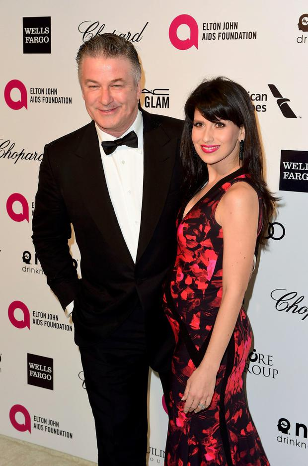 Actor Alec Baldwin and his wife Hilaria Thomas arrive at the 2015 Elton John AIDS Foundation Oscar Party in West Hollywood