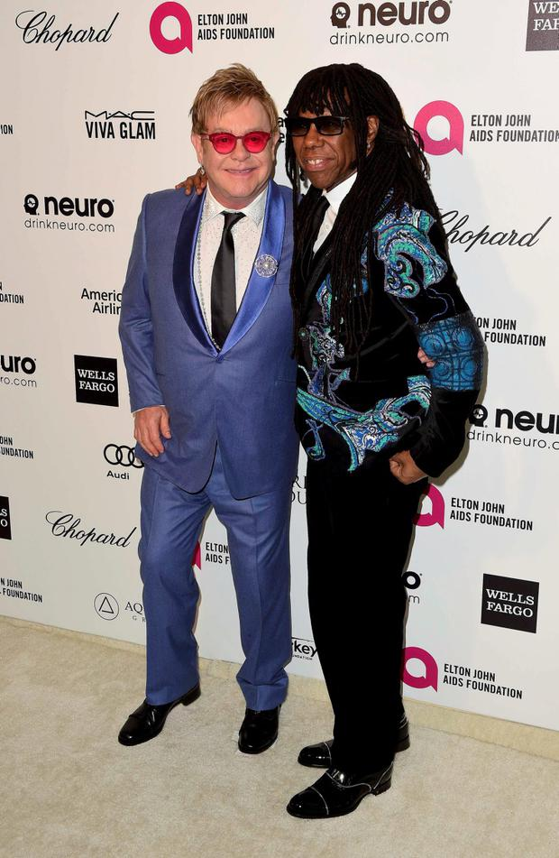 Sir Elton John and musician Nile Rodgers arrive at the 2015 Elton John AIDS Foundation Oscar Party in West Hollywood
