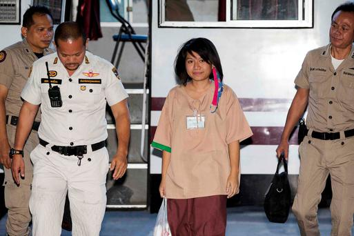 Porntip Mankong (C), 26, arrives at Bangkok's Criminal Court for the final hearing in her case on charges of lese majeste
