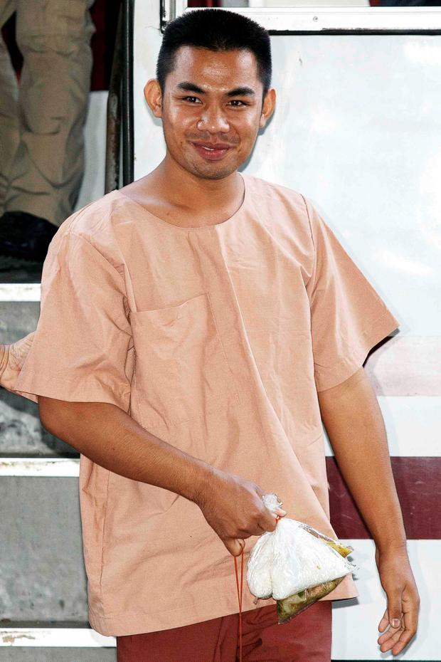 Patiwat Saraiyaem, 23, arrives at Bangkok's Criminal Court for the final hearing in his case on charges of lese majeste