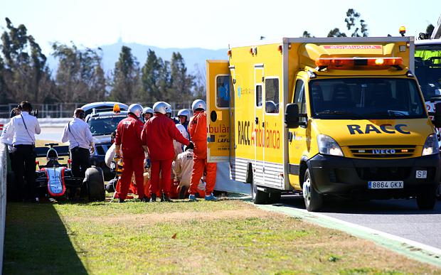 Rescue mission: Ambulance staff arrive on track to attend to Fernando Alonso Photo: GETTY IMAGES