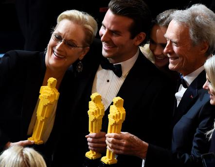 Clint Eastwood (R), Meryl Streep (L) and Bradley Cooper pose for a photo with Oscars made of lego bricks after the end of the 87th Oscars February 22, 2015 in Hollywood, California.