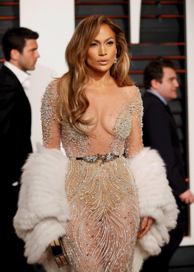 Actress Jennifer Lopez arrives at the 2015 Vanity Fair Oscar Party in Zuhair Murad