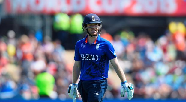 England captain Eoin Morgan heads back to the dressing room after losing his wicket during the 2015 ICC Cricket World Cup match between England and Scotland at Hagley Oval