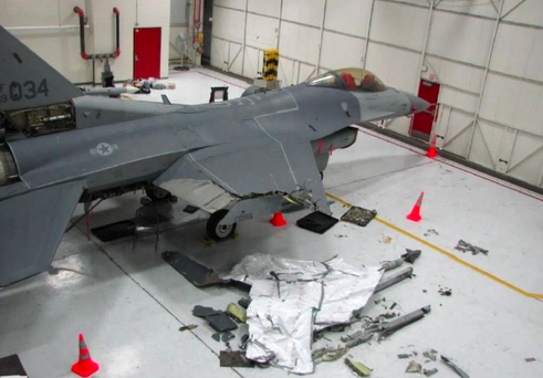 A US Air Force F-16C, flown by its pilot for 100 miles after losing part of its wing in October, 2014. Photo: US Air Force