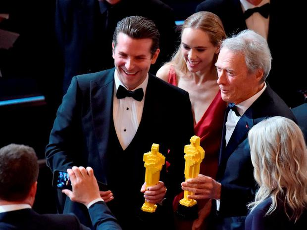 Actor Bradley Cooper (L) and actor/director Clint Eastwood with guests onstage during the 87th Annual Academy Awards at Dolby Theatre