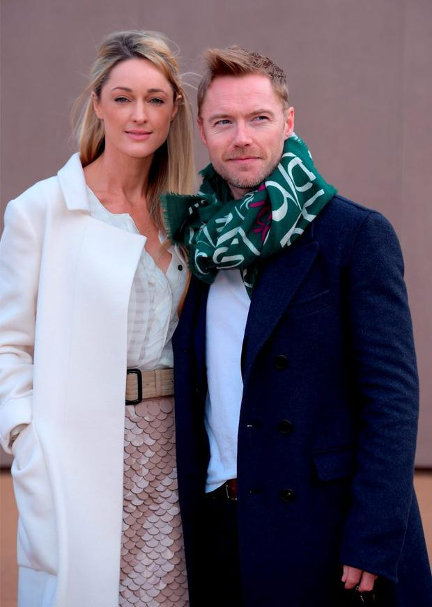 Storm Uechtritz and Ronan Keating attend the Burberry Prorsum AW 2015 arrivals during London Fashion Week at Kensington Gardens