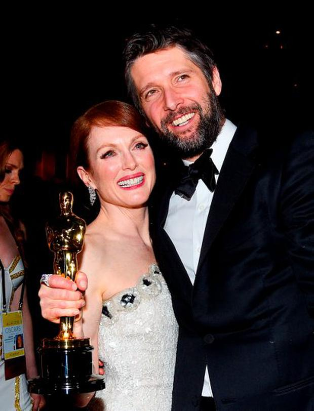 Here, she celebrates with her husband Bart Freundlich (who predicted her Oscar win after he first saw Still Alice).