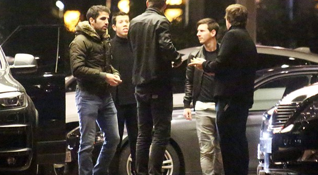 Pique (centre) and Fabregas (left) were joined by Barcelona superstar Lionel Messi (second right)