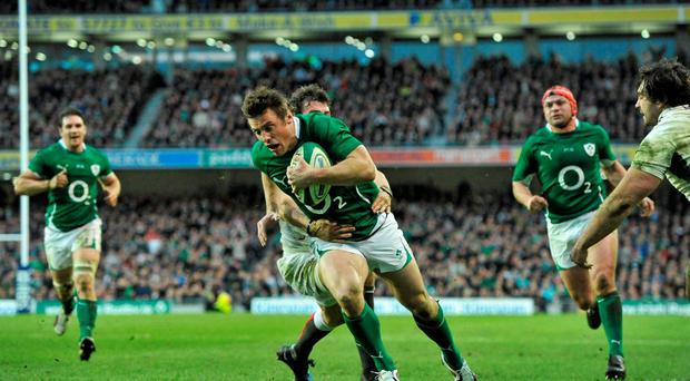 Tommy Bowe scores a try in 2011 against England