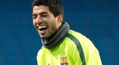 Barcelona's Uruguayan forward Luis Suarez takes part in a team training session