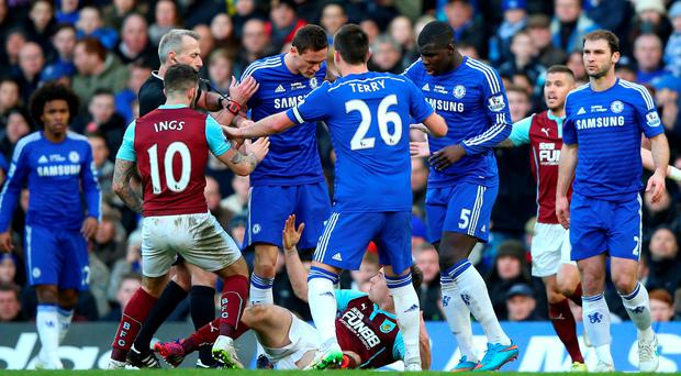 Burnley's Ashley Barnes (on ground) protests his innocence after being pushed to the ground by Chelsea's Nemanja Matic, who was subsequently sent off at Stamford Bridge