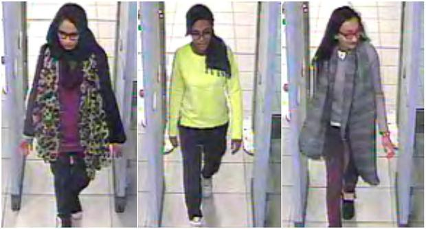 British teenage girls Shamima Begun, Amira Abase and Kadiza Sultana (left to right), walk through security at Gatwick airport before they boarded a flight to Turkey
