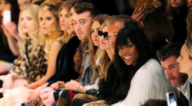 (3rd R - L) Model Naomi Campbell, photographer Mario Testino, model Kate Moss, model Cara Delevingne, singer Sam Smith, actor Maggie Gyllenhaal, actor Clemence Poesy, singer Paloma Faith and model Lily Donaldson watch the presentation of the Burberry Prorsum Autumn/Winter 2015 collection during London Fashion Week February 23, 2015