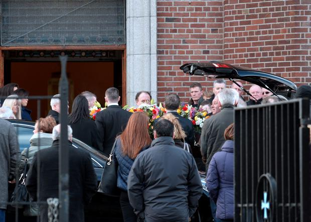 General view of coffin of Edward (Eddie) Nugent being carried into the church