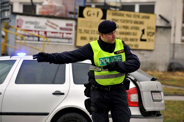 A police officer controls traffic near a restaurant where a gunman opened fire in Uhersky Brod, east of the Czech Republic, Tuesday, Feb. 24, 2015. (AP Photo/CKT, Dalibor Gluck)