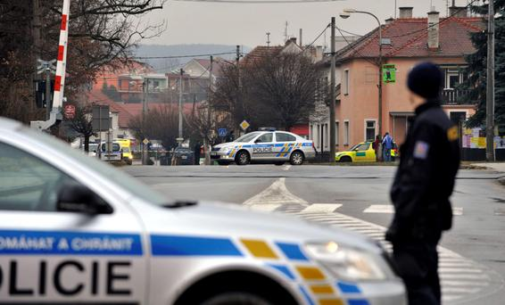 A police officer patrols near a restaurant where a gunman opened fire injuring at least one person in Uhersky Brod, in the east of the Czech Republic, Tuesday, Feb. 24, 2015. Police did not immediately release any details. (AP Photo/CKT, Dalibor Gluck)