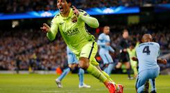Luis Suarez celebrates giving Barcelona the lead against Manchester City in the Champions League last night