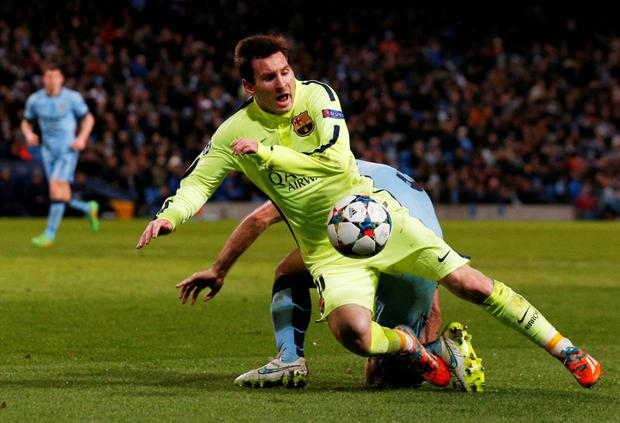 Barcelona's Lionel Messi is fouled by Manchester City's Pablo Zabaleta for a penalty