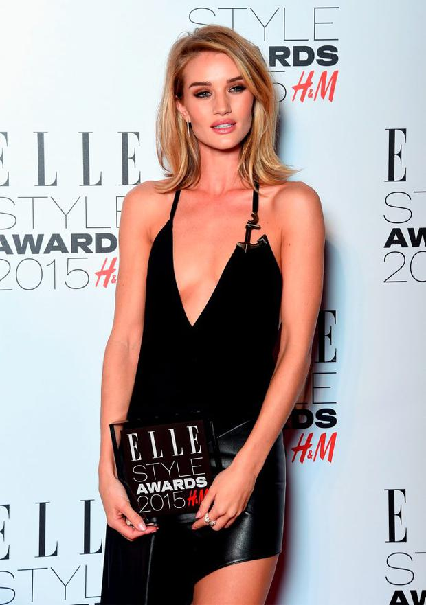 Rosie Huntington-Whiteley with her Model of the Year award during the Elle Style Awards 2015