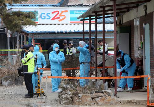 South Korean police officers investigate the scene of an incident in Sejong, south of Seoul, South Korea. (AP Photo/Yonhap, Yang Young-suk)