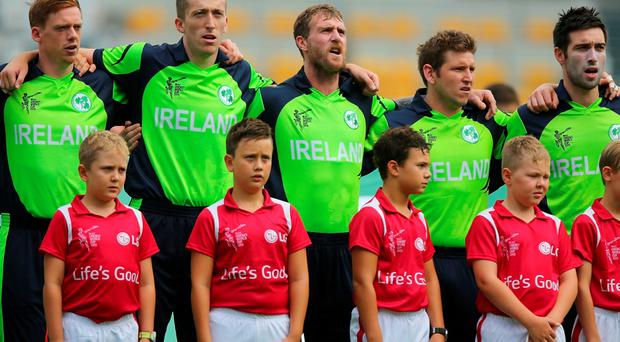 Ireland sing the national anthem before the start of play during the 2015 ICC Cricket World Cup match between Ireland and the United Arab Emirates