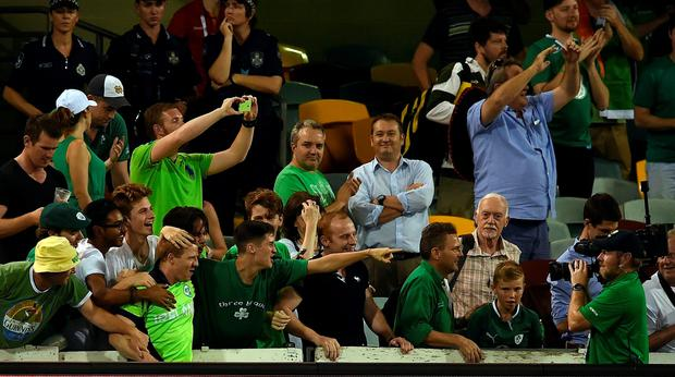 Ireland cricketer Niall O'Brien poses with fans as they celebrate after winning the 2015 Cricket World Cup Pool B match between Ireland and united Arab Emirates (UAE) at the Gabba in Brisbane on February 25, 2015. AFP PHOTO / INDRANIL MUKHERJEE -- IMAGE RESTRICTED TO EDITORIAL USE - STRICTLY NO COMMERCIAL USE--INDRANIL MUKHERJEE/AFP/Getty Images