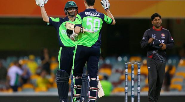 Alex Cusack and George Dockrell celebrate winning the 2015 ICC Cricket World Cup match against the United Arab Emirates at The Gabba