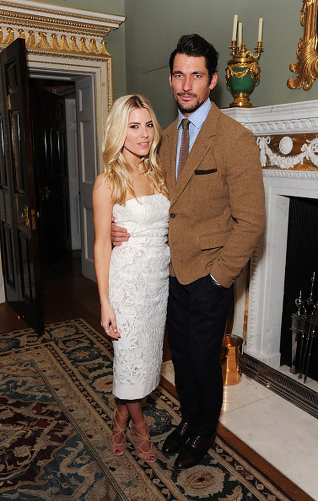 Mollie King (L) and David Gandy attend the Creative London party hosted by the British Fashion Council and BPI at Spencer House on February 23, 2015 in London, England.