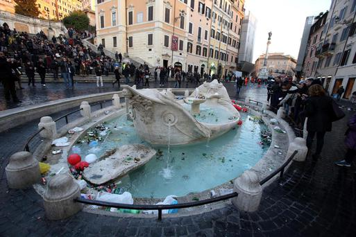 The Barcaccia fountain, designed by famed sculptor Pietro Bernini, was damaged bu Dutch football fans