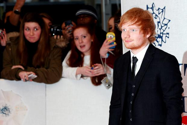Singer Ed Sheeran arrives for the BRIT music awards at the O2 Arena in Greenwich