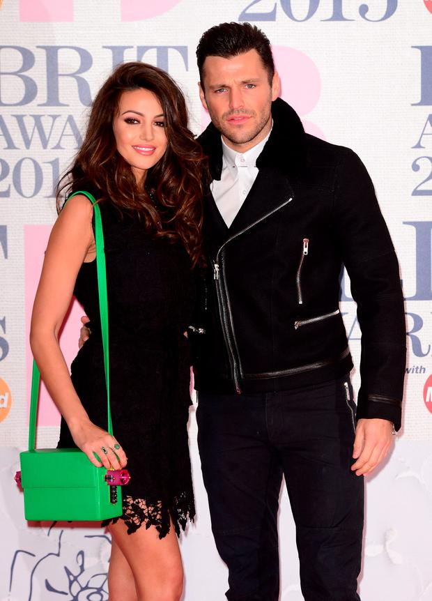 Michelle Keegan and Mark Wright arriving for the 2015 Brit Awards at the O2 Arena, London.