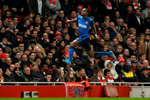 Monaco's French midfielder Geoffrey Kondogbia celebrates scoring against Arsenal at the Emirates Stadium